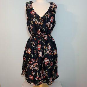 Pretty sleeveless, ruffle neckline floral dress
